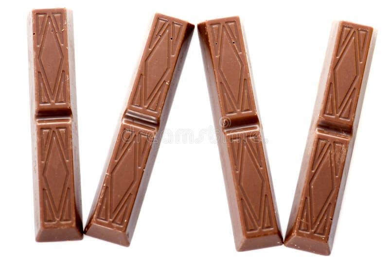 Cioccolato su priorità bassa bianca immagini stock libere da diritti