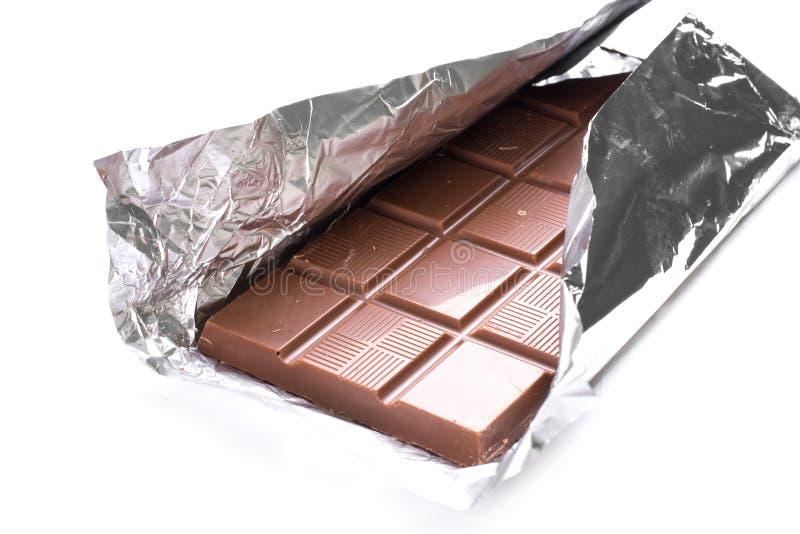 Cioccolato su priorità bassa bianca immagine stock