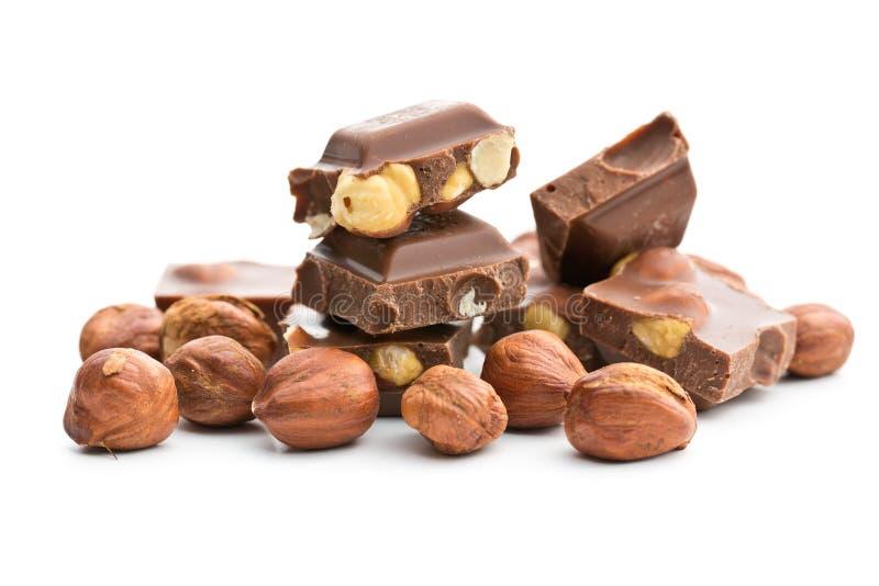 Cioccolato zuccherato con le nocciole immagine stock