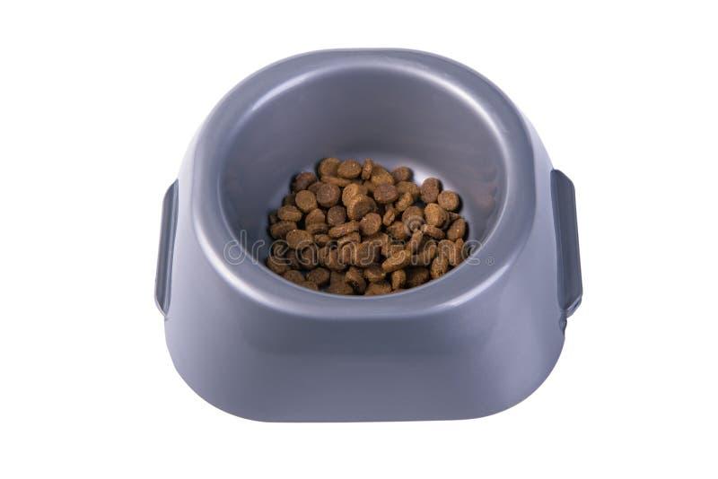 Ciotola con l'alimento di gatto asciutto fotografia stock