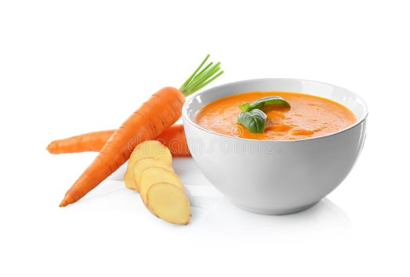 Ciotola con la minestra saporita dello zenzero della carota fotografia stock