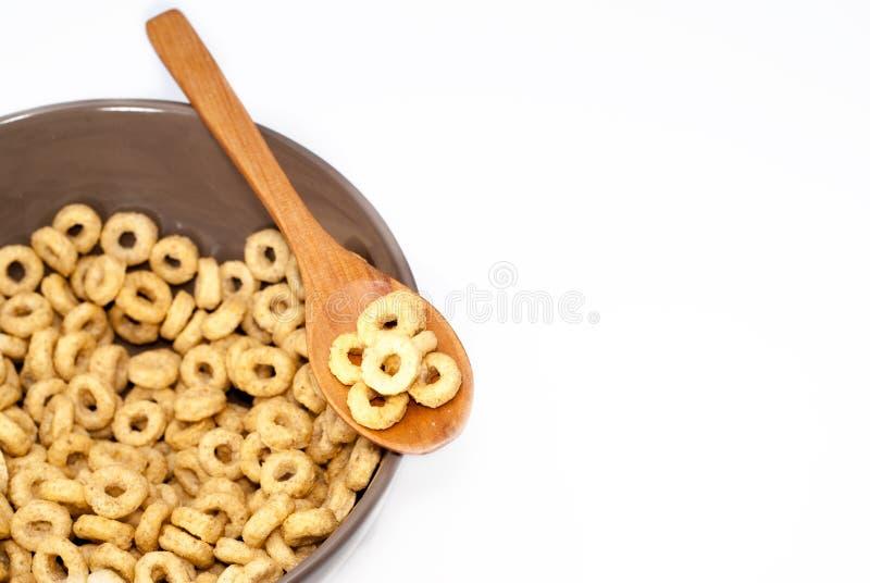 Ciotola di Brown con i cereali immagini stock
