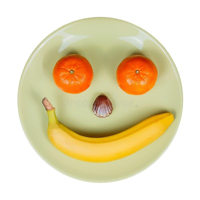 Ciotola di frutta, presentata sotto forma di fronte sorridente fotografia stock