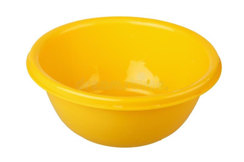Ciotola di plastica gialla immagini stock