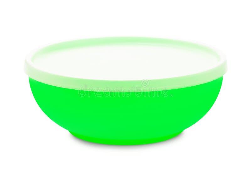 Ciotola di plastica verde chiusa immagini stock