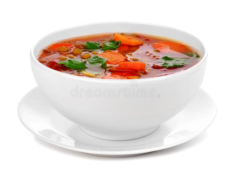 Ciotola di pomodoro casalingo, minestra di lenticchia isolata su bianco fotografie stock libere da diritti