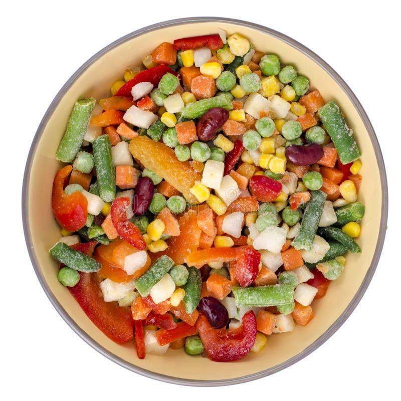 Ciotola di verdure congelate miscela per la cottura dei piatti vegetariani, concetto sano di cibo fotografia stock libera da diritti