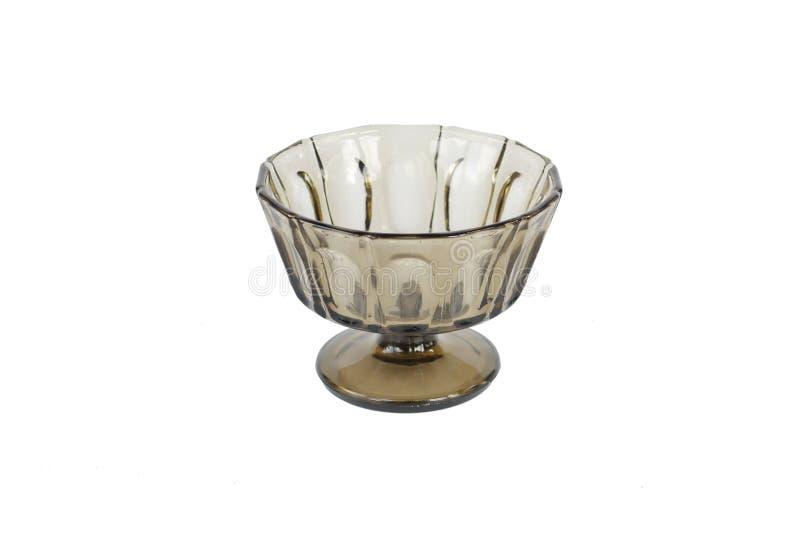 Ciotola di vetro tradizionale brunastra scura con il supporto Front View immagini stock
