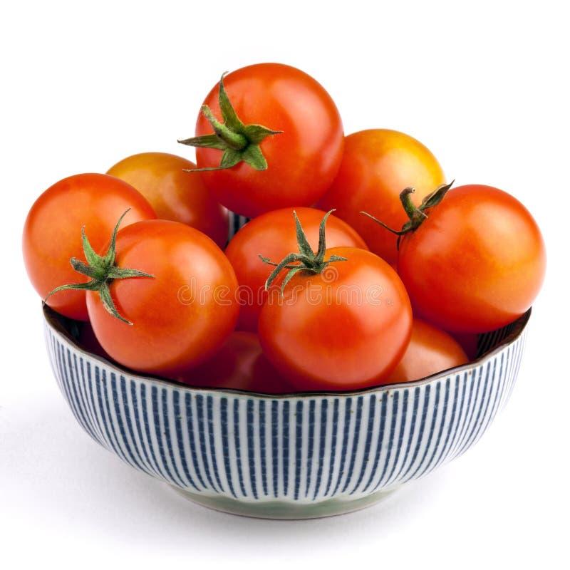 Ciotola in pieno di pomodori fotografie stock libere da diritti