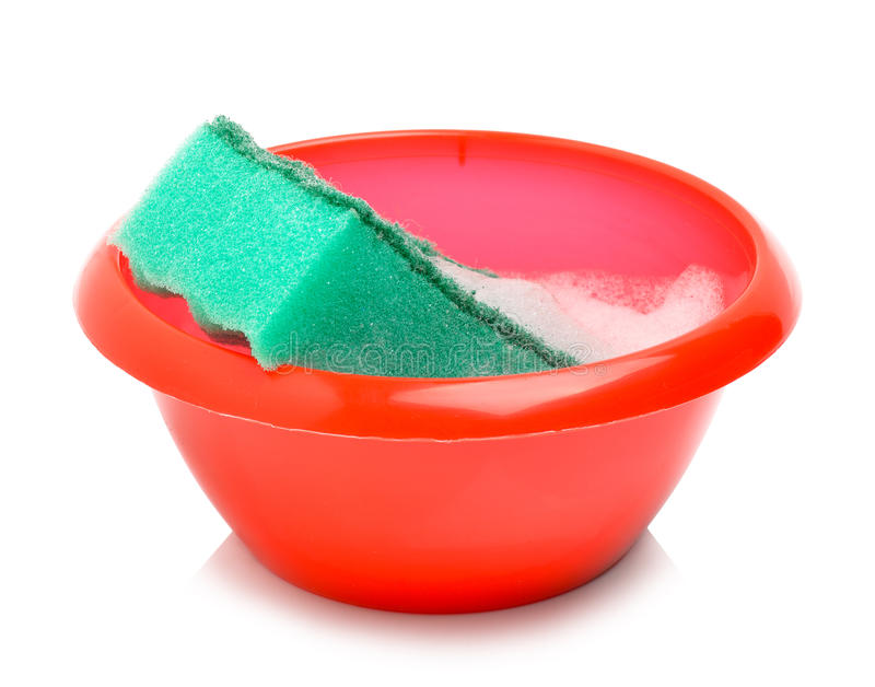 Ciotola rossa e spugna verde con schiuma fotografie stock