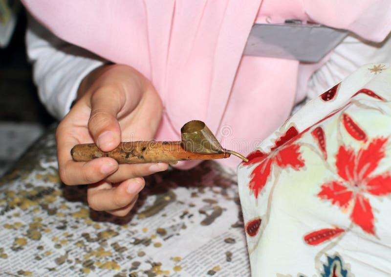 Cirage du batik photo libre de droits