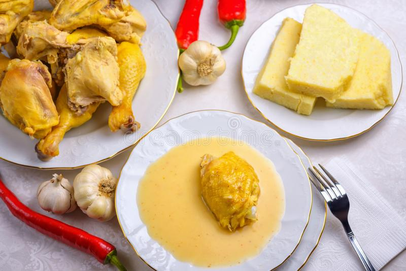 Circassian Adyghe traditional folk dish. Boiled chicken with sour cream sauce djedlibje Served with pasta stock photos