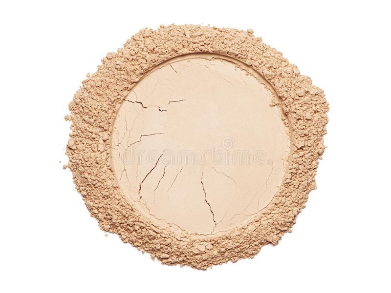 Foundation powder. Circle of a broken make up powder on white background stock images