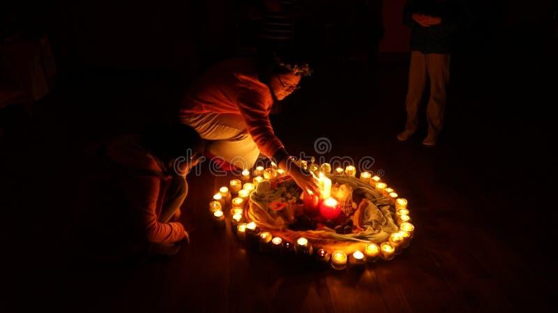 Circle of burning candles stock photography