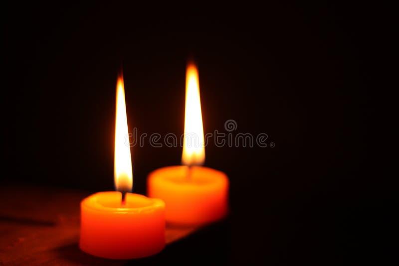 Circle candle light isolated on black background. stock photos