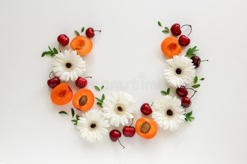 Circle composition, arrangement of flowers and fruits stock photo