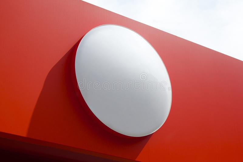 Circle empty signboard isolated on red background. royalty free stock photos