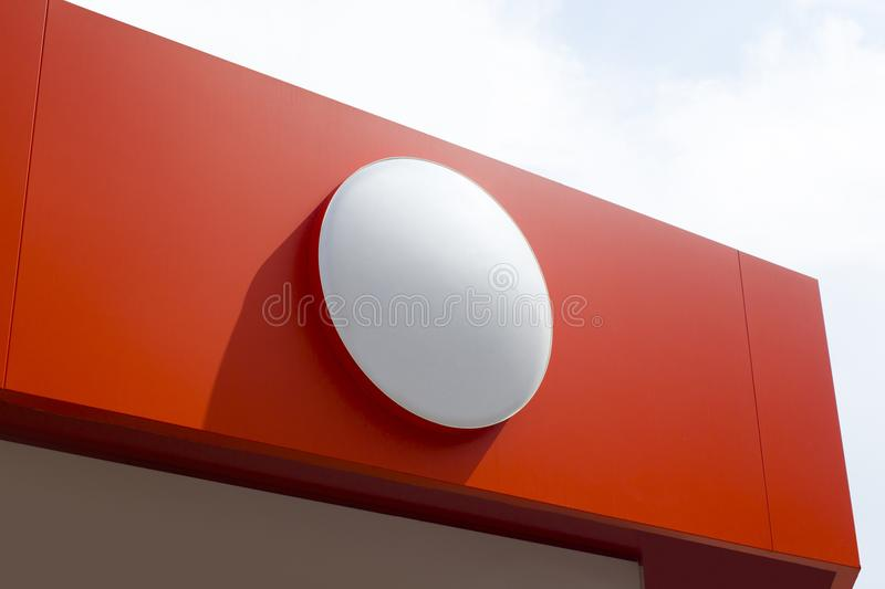 Circle empty signboard isolated on red background. stock photography