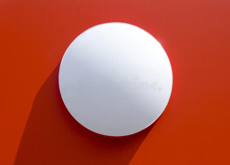 Circle empty signboard on red background. stock photos