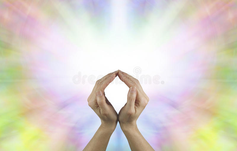The Circle of Eternal Life. Female hands making an O shape with a vibrant burst of white light energy behind filled by a rainbow colored butterfly shape and stock images