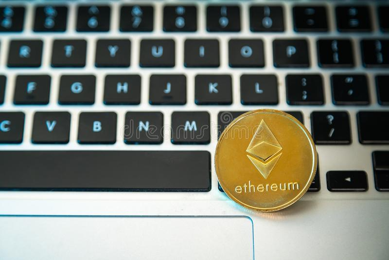 Circle Ethereum coin on top of computer keyboard buttons. Digital currency, block chain market, online business.  stock image