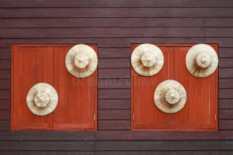 circle farmer hat on wooden background with windows royalty free stock images
