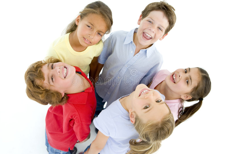 Circle of five young friends smiling stock images
