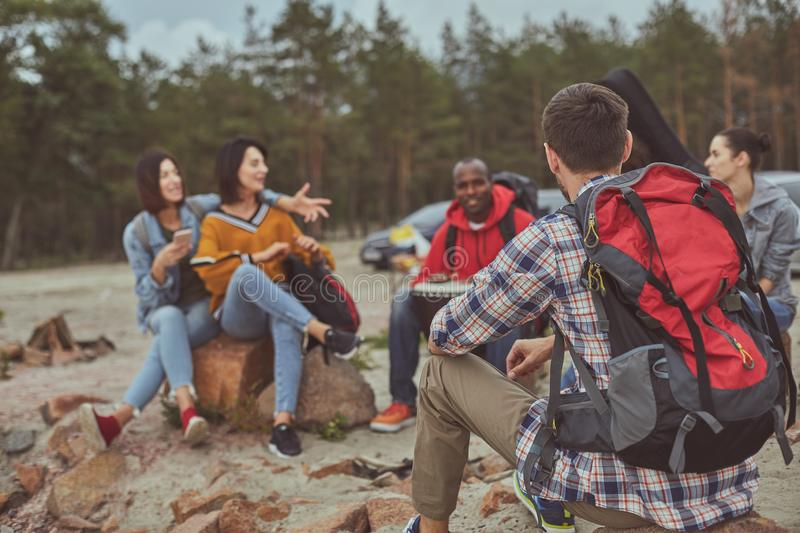 Happy friends spending their time outdoor during vacation royalty free stock photo