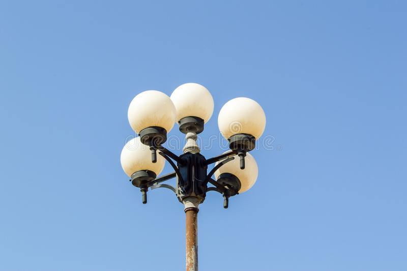 Circle lamp post. In garden stock photography