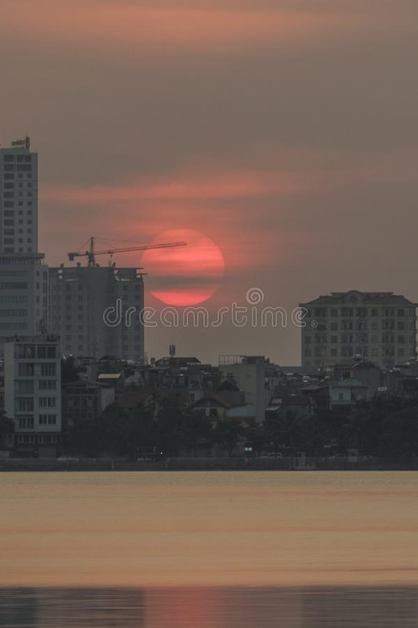 Circle of life. Can see it tomorrow. WestLake ís a large lake in Hanoi, Vietnam, Where you can see sunrise and also sunset with beauty sky with full of colors stock photography