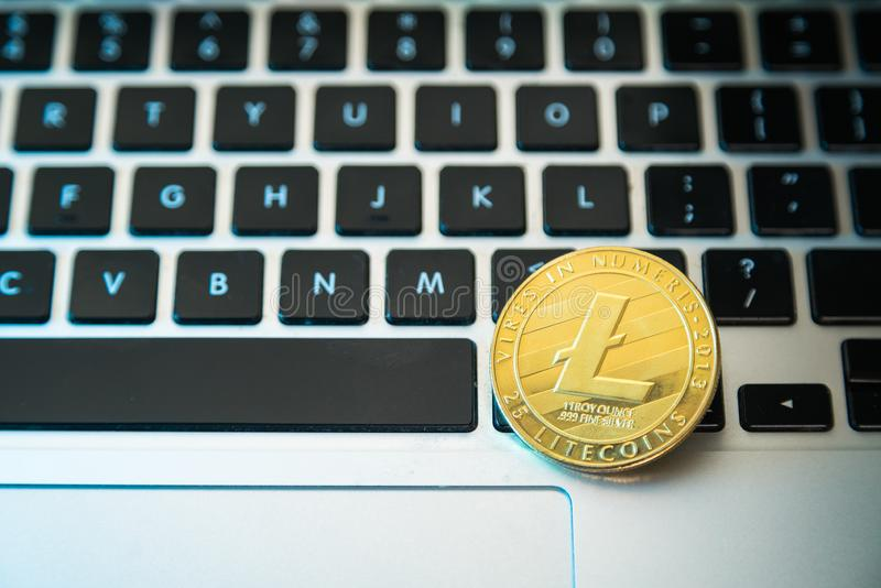 Circle Litecoin, lite coin on top of computer keyboard buttons. Digital currency, block chain market, online business.  royalty free stock photo