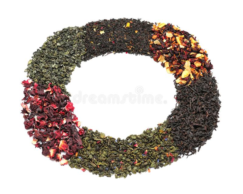 Circle made of different types of dry tea leaves on white background stock images