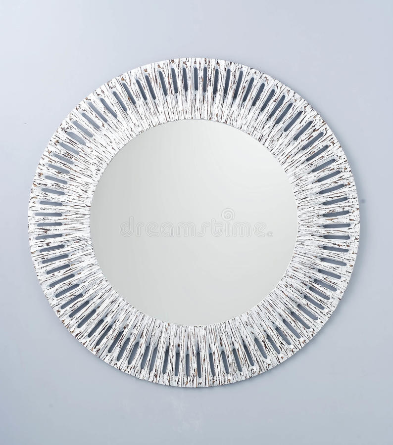 Circle mirror created by white wood frame. It`s design in vintage style stock image