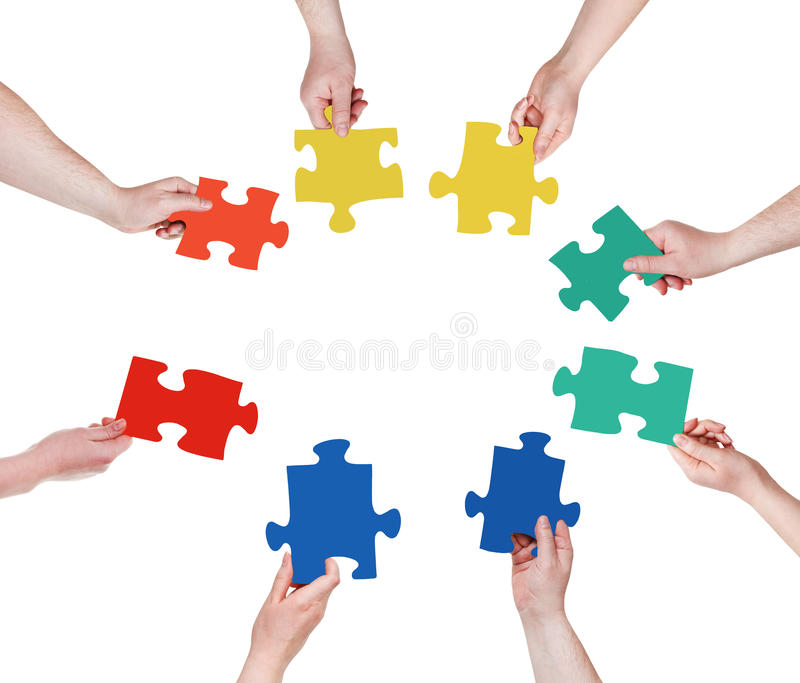 Circle of people hands with puzzle pieces stock photo
