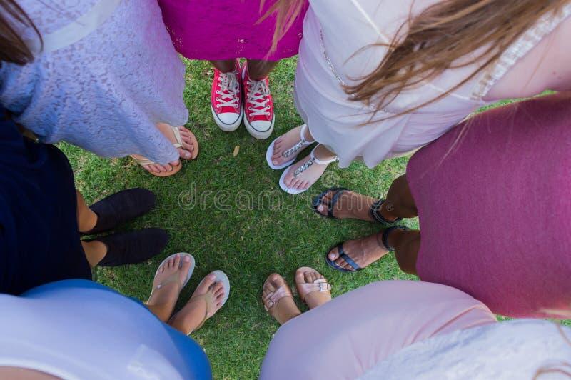 Circle teenage girls feet royalty free stock photo