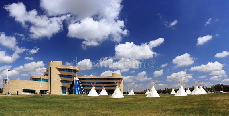 Big Sky over Circle of Tipis at First Nations University in Regina, Saskatchewan, Canada. The big sky and clouds above the over circle of tipis emphasize the royalty free stock photos