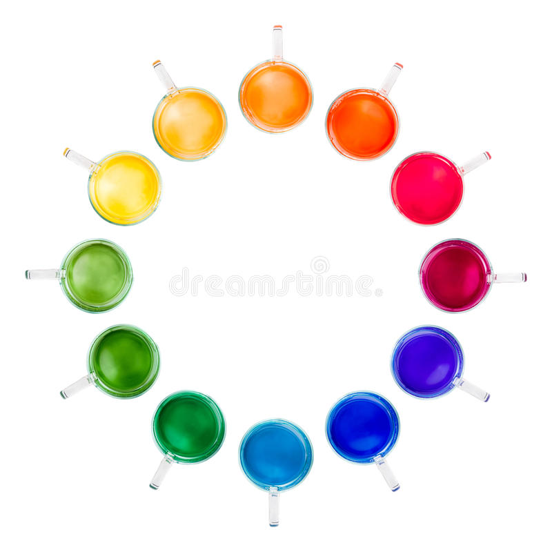 Circle of twelve glass mugs with multicolored drinks stock images