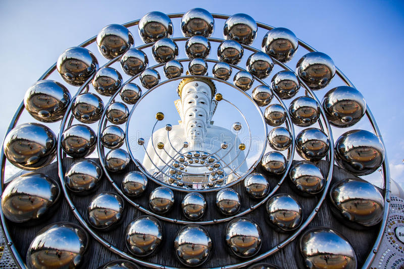 Circle and white buddha statue. White buddha statue in circle of steel and blue sky stock photos