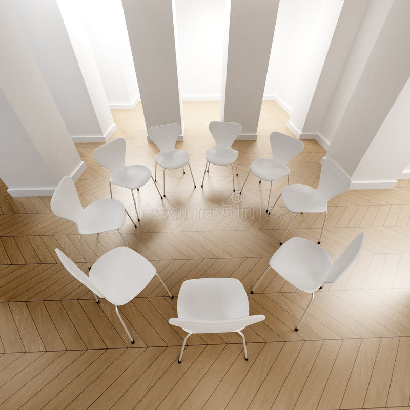 Circle of white chairs stock photography