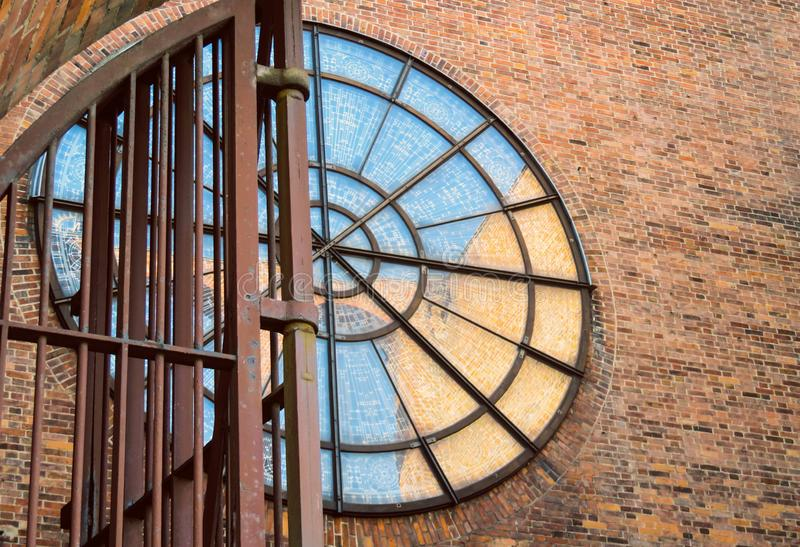 Circle windows on old brick building wall royalty free stock photography