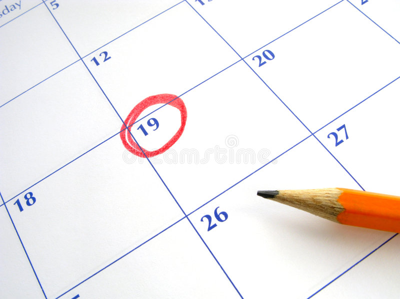 Circled date on a calendar. A circled date on a calendar royalty free stock photos