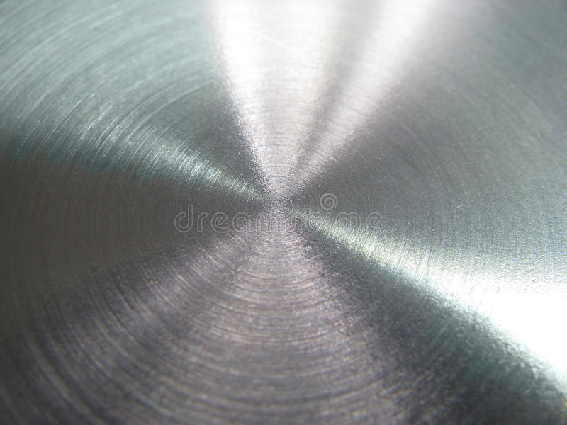 Circled steel background. Circled grey stainless steel surface royalty free stock image