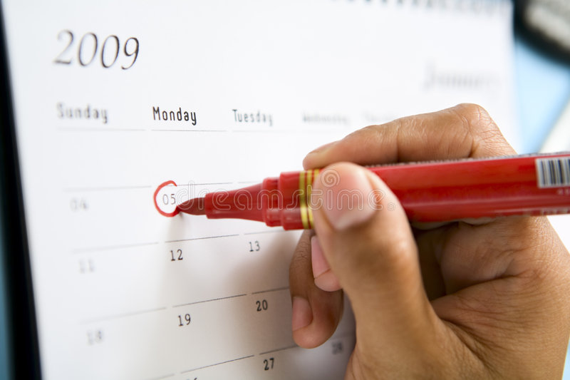 Circling the date royalty free stock photos