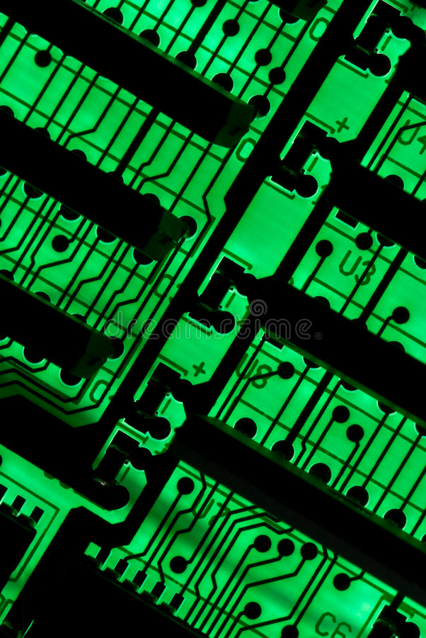 Circuit background. Green circuit board closeup lit from below through the board, creating a unique glow effect royalty free stock photography