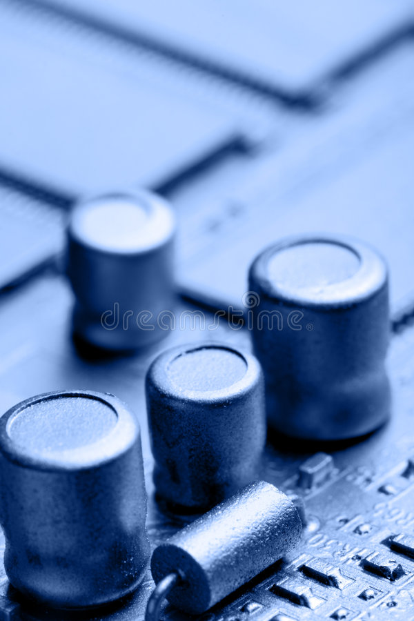 Circuit board. Close-up toned in blue color. Shallow DOF royalty free stock image