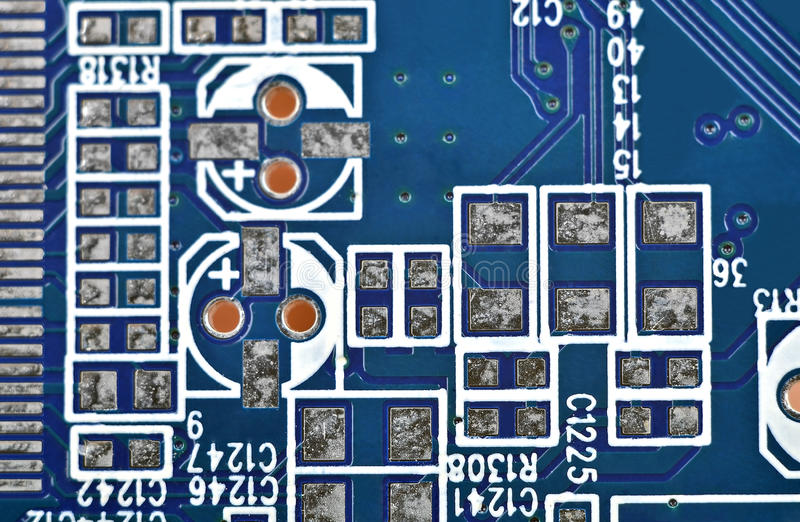 Circuit board background. Close up of a printed blue computer circuit board stock images