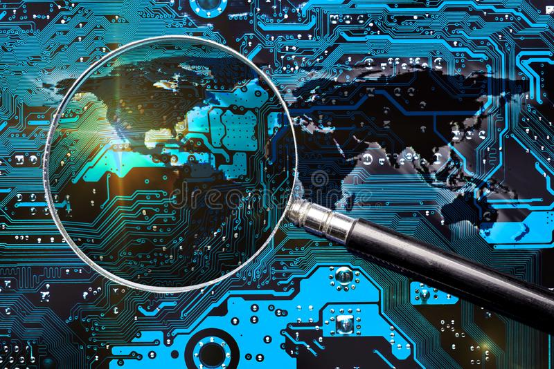 Circuit board, world map and magnifier glass stock photo