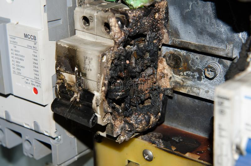 Circuit breaker main burn fire in control box. Black royalty free stock images