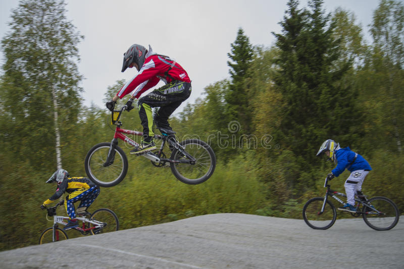 Circuit championship in bmx cycling, full-speed and high jump royalty free stock photography