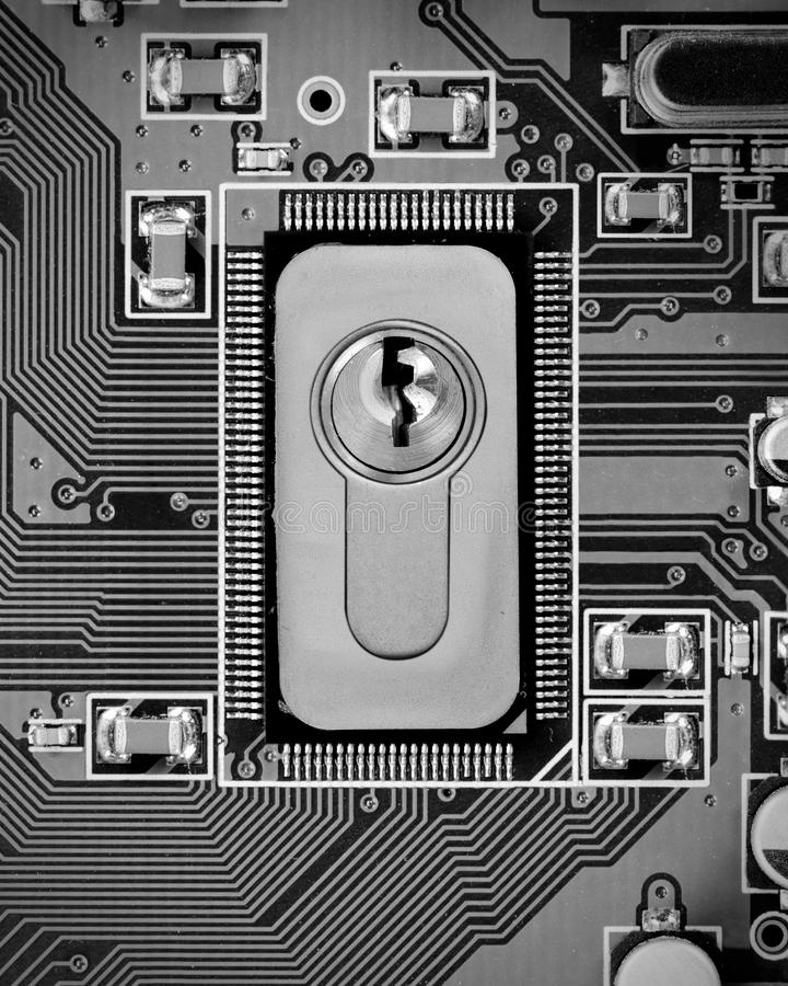 Circuitboard and Chip Concept. Macro photo of circuit board and chip with lock; concept of cyber security royalty free stock image